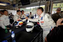 Pole winner Stéphane Sarrazin celebrates with Marc Gene