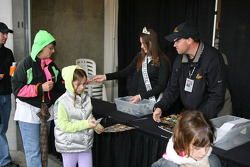 A 500 Princess hands out collector pins to race fans on day two of qualifications