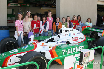Fan poses with Tony Kanaan's car