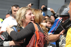 Sabine Schmitz celebrates third place