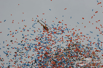 A television helicopter is engulfed by the balloon release