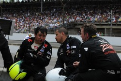Bruno Junqueira's pit crew taking a break