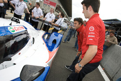 Lucas Luhr and Mike Rockenfeller check out the #10 Charouz Racing System Lola Aston Martin