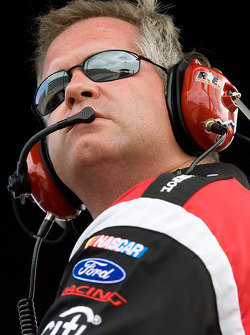 Bob Osborne sits atop the pit box