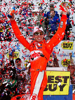 Victory lane: race winner Kyle Busch celebrates