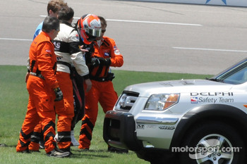 Dan Wheldon limping out of his car