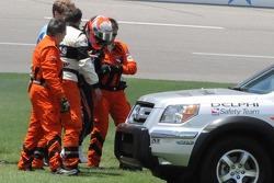 Dan Wheldon limping out of his car