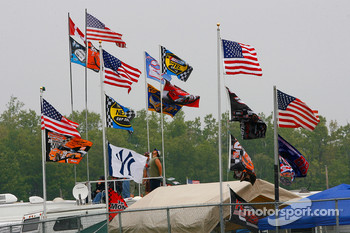 Race fans display the American flag as well as their driver flags and one Yankees fan shows his loyalty in the turn 3 infield