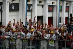 Toyota F1 team members celebrate the third place of Jarno Trulli