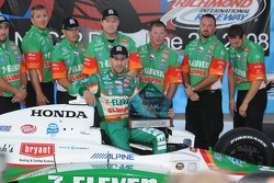 Pole winner Tony Kanaan wiPole winner Th his Pole winner Team