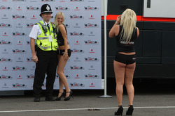 Girls in the paddock have their picture taken with Police