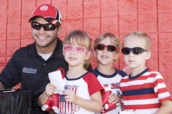 Reed Sorenson poses with a set of triplets