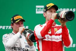 Podium: winner Nico Rosberg, Mercedes AMG F1 W06 with third place Sebastian Vettel, Ferrari SF15-T