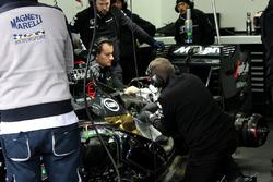 Mechanics work on Stoffel Vandoorne's McLaren