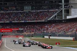 Start: Lewis Hamilton, McLaren Mercedes, MP4-23, takes the lead