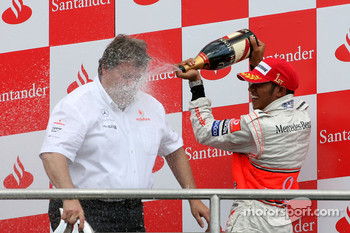 Podium: champagne for Lewis Hamilton and Norbert Haug