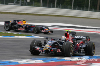 Sebastian Vettel, Scuderia Toro Rosso, STR02 leads Mark Webber, Red Bull Racing, RB4