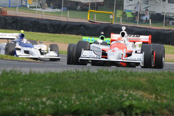 Ryan Briscoe leads Ryan Hunter-Reay and Buddy Rice