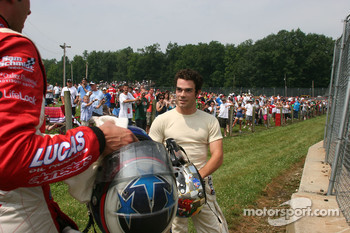 Logan Gomez listens to Richard Antinucci after their crash in the