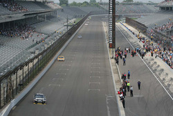 Cars come down the long front straight at the Indianapolis Motor Speedway