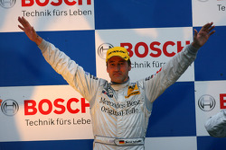 Podium: race winner Bernd Schneider celebrates