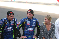 Chad Knaus, Jimmie Johnson and his wife Chandra prepare to kiss the bricks