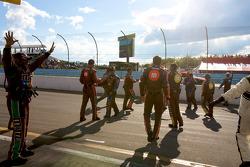 M&M's Toyota crew members celebrate victory