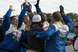 STP Ford crew members celebrate the win of Marcos Ambrose