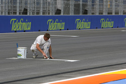 A man painting the grid lines