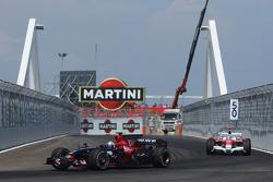 Sebastian Vettel, Scuderia Toro Rosso, STR03 and Jarno Trulli, Toyota Racing, TF108