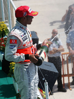 Podium: Lewis Hamilton celebrates with champagne
