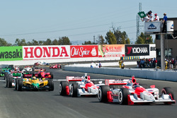 Helio Castroneves leads the field at the start