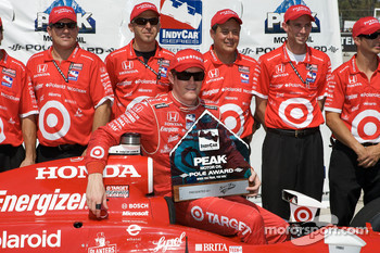 Pole winner Scott Dixon celebrates with his team
