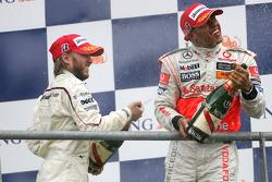 Podium: Lewis Hamilton and Nick Heidfeld spray champagne