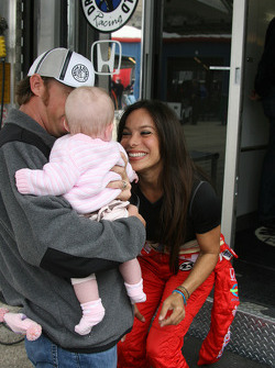 Buddy Rice shows off his daughter to Milka Duno