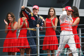 Podium: race winner Sebastian Vettel celebrates with Heikki Kovalainen