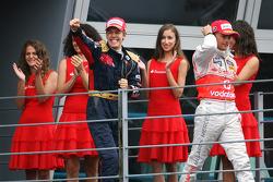 Podium: race winner Sebastian Vettel celebrates with Heikki Kovalainen