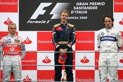 Podium: race winner Sebastian Vettel, second place Heikki Kovalainen, third place Robert Kubica