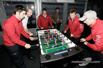 Allan McNish, Rinaldo Capello, Mike Rockenfeller and Alexandre Prmat play fussball at the Audi Sport Team Joest hospitality