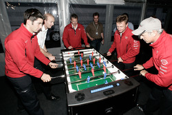 Allan McNish, Rinaldo Capello, Mike Rockenfeller and Alexandre Prémat play fussball at the Audi Sport Team Joest hospitality
