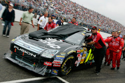 Greg Biffle's crew pushes the Dish Network Ford to the starting grid