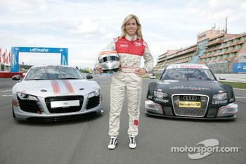 Maria de Villota poses with an Audi R8 and an Audi A4 DTM