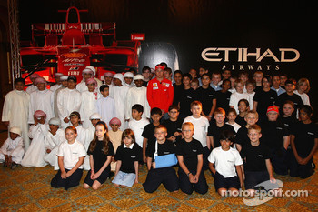 Kimi Raikkonen of Ferrari meets local school children the Abu Dhabi Etihad Airways F1 Grand Prix 2009 at The Emirates Palace
