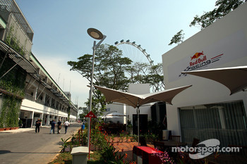 the paddock and the Red Bull Racing hospitality area with the Singapore Flyer in the background