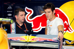 A crew member and Mark Webber