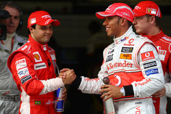 Pole winner Lewis Hamilton celebrates with Felipe Massa