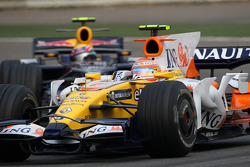 Nelson A. Piquet, Renault F1 Team, R28 leads Mark Webber, Red Bull Racing, RB4