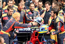 Scuderia Toro Rosso team shot, Crew members with the helmets of Sebastian Vettel and Sébastien Bourdais