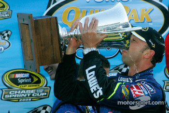 Victory lane: Chad Knauss drinks champagne