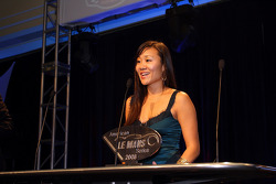 Younghee Wong accepting Audi Sport North America P1 team championship award